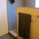Bathroom remodeling - flooring, tiling and half wall construction