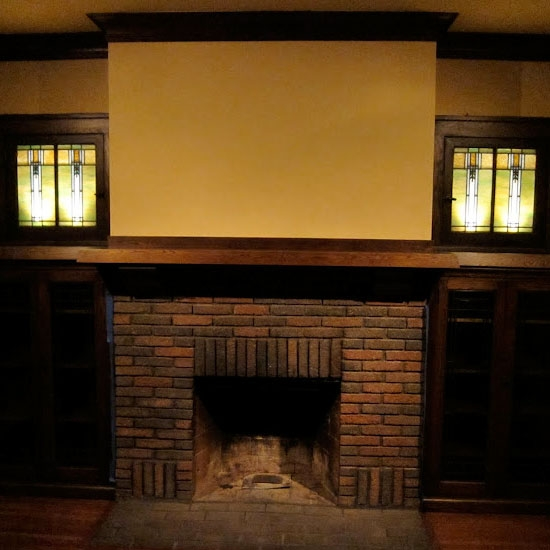 Living room - fireplace, stained glass & built ins