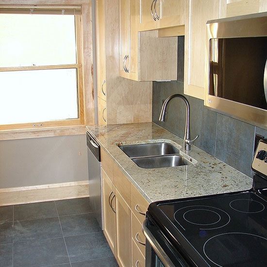 Kitchen remodeling - sink, counter tops, flooring, cabinets & appliances