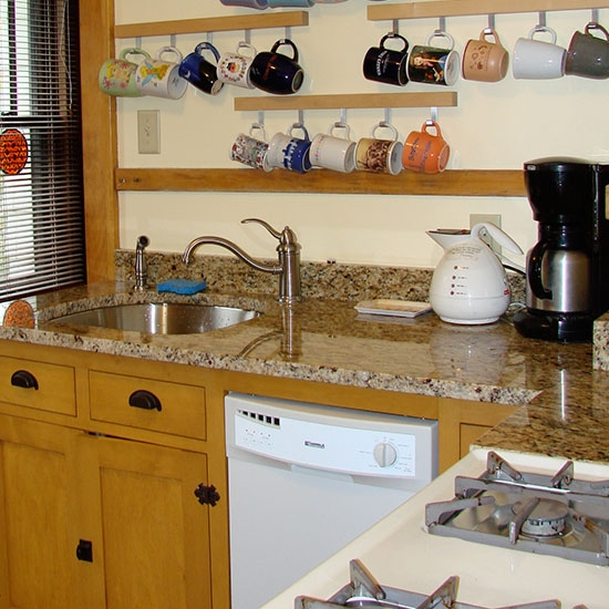 Kitchen remodeling - sink, appliances, custom cabinetry & counter tops