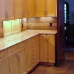 Kitchen remodeling - custom cabinetry, lighting, counter tops and tile back splashing