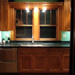 Kitchen remodeling - lighting, trim work, counter tops, sink, custom cabinetry & appliances