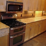 Kitchen remodeling - custom cabinetry, appliances, counter tops and tile back splashing