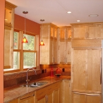 Kitchen remodeling - custom cabinetry, lighting, sink, tile back splashing & counter tops