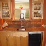 Kitchen remodeling - custom cabinetry, wet bar, lighting & wine cooler