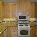 Kitchen remodeling - cabinets, tile back splashing, appliances & lighting
